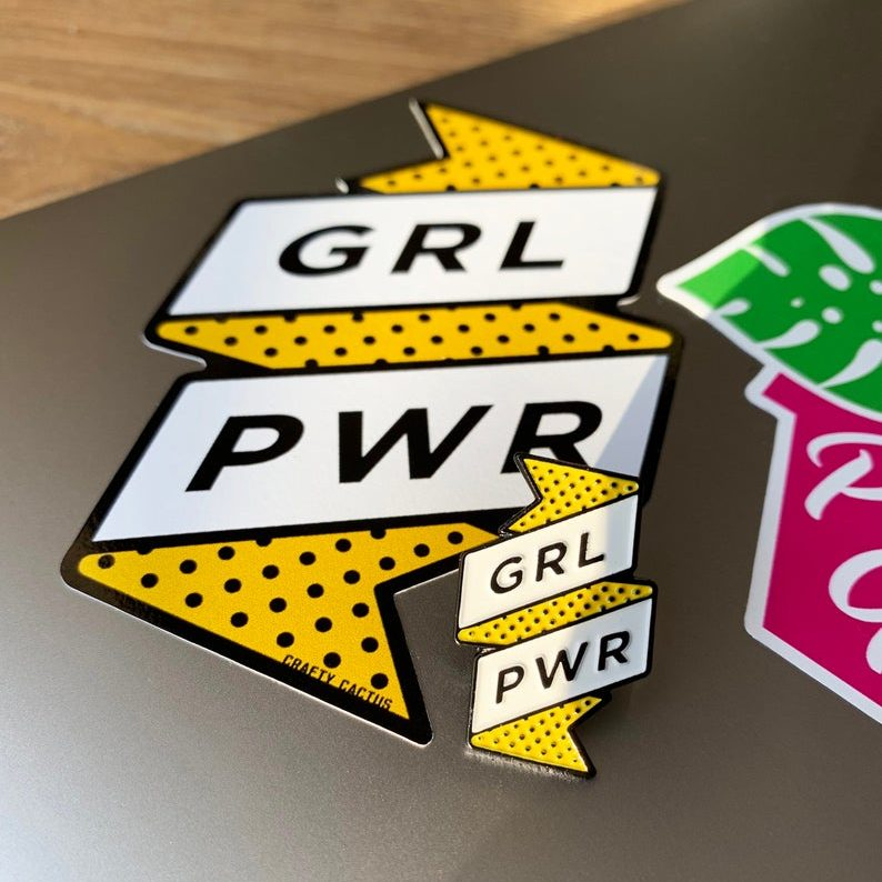 GRL PWR enamel pin and vinyl sticker, £8, Crafty Cactus Company.